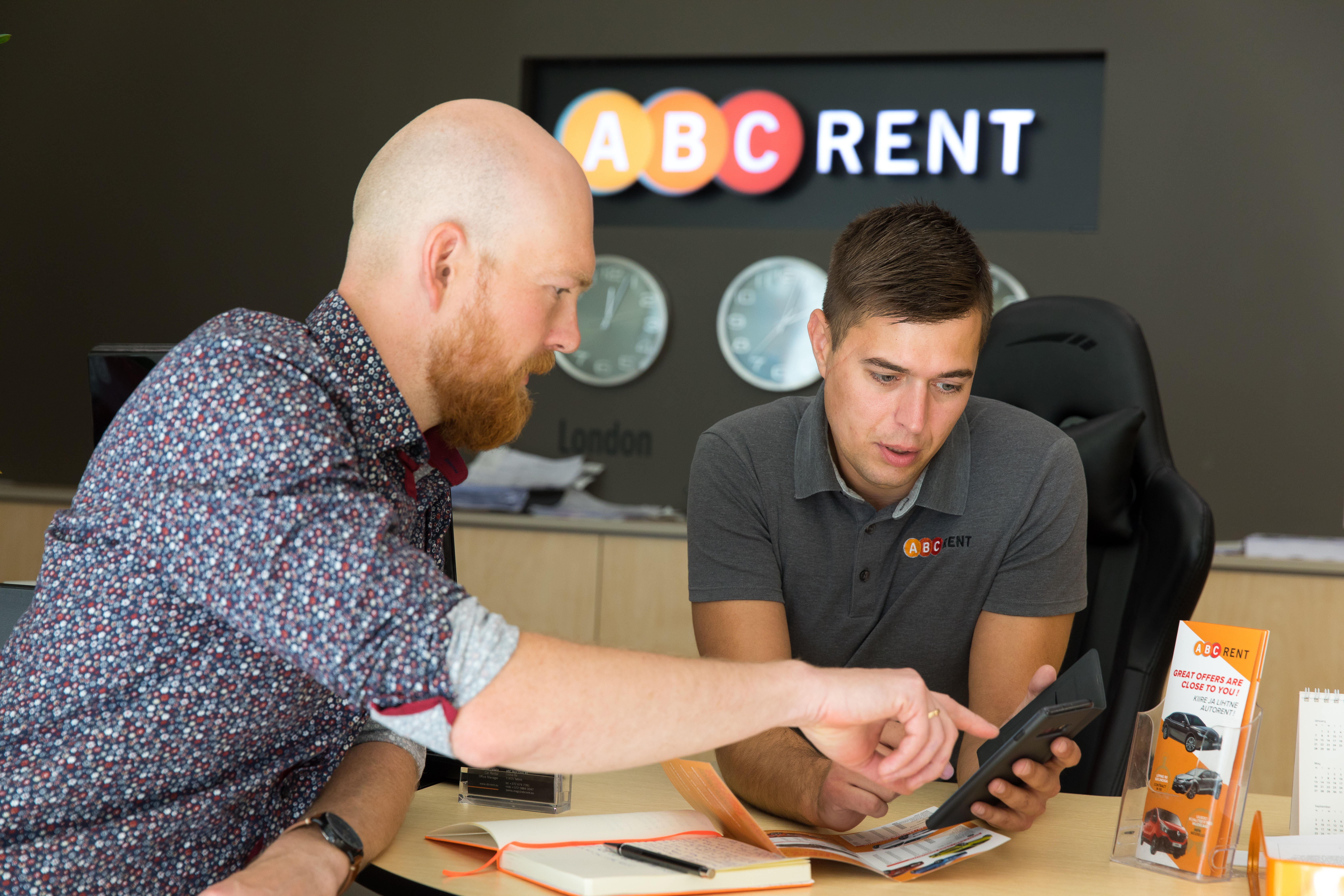 ABC Rent_Fleet Complete_ Two men looking at mobile app